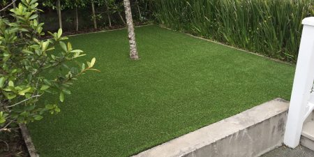 Clean and neat artificial grass on the backyard