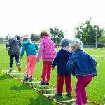 children playing on grass